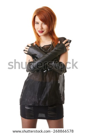 Beautiful red-haired woman in gothic outfit - stock photo