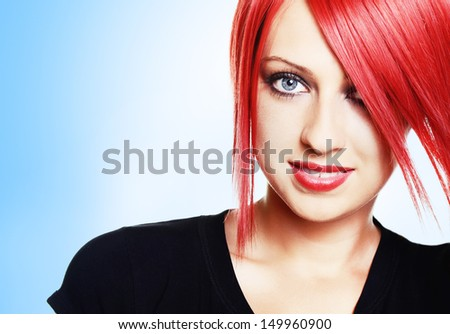 Beautiful red haired woman over white background