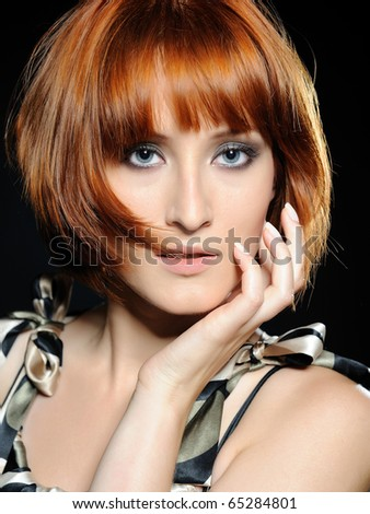 Beautiful red haired woman with fashion bob hairstyle and creative trendy make-up - stock photo