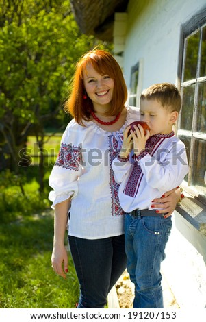 Beautiful red-haired woman with the four-year-old son
