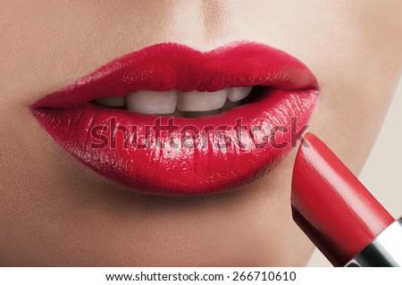 Beautiful red lips with lipstick. - stock photo