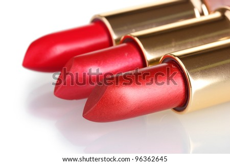 beautiful red lipsticks isolated on white