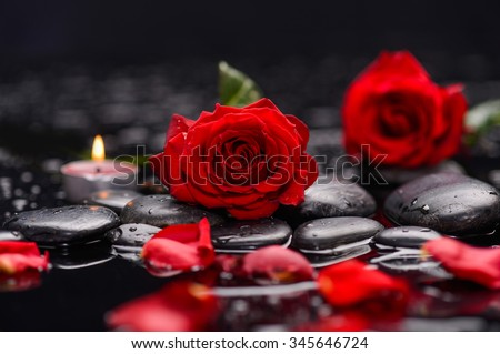 Beautiful red rose,petals with candle and therapy stones  - stock photo
