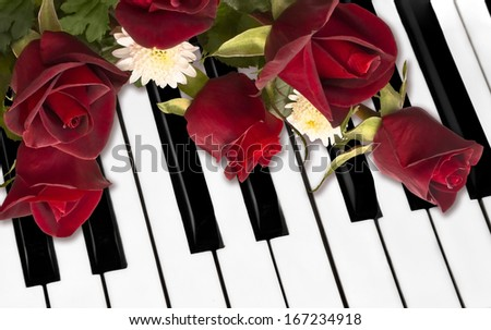 Beautiful red roses on piano