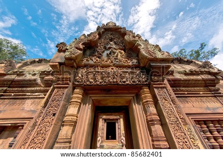 Beautiful red sandstone carvings at the Banteay Srei temple, Cambodia - stock photo