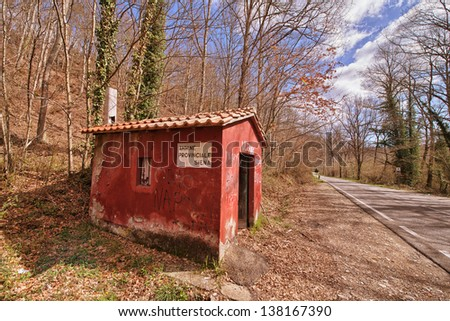 Beautiful Red Small House isolated on brown countryside. - stock photo