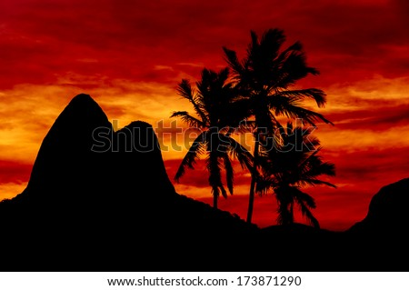 Beautiful Red Sunset With Mountains and Palms in Ipanema Beach, Rio de Janeiro, Brazil - stock photo