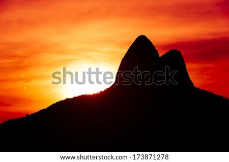 Beautiful Red Sunset With Mountains in Ipanema Beach, Rio de Janeiro, Brazil - stock photo