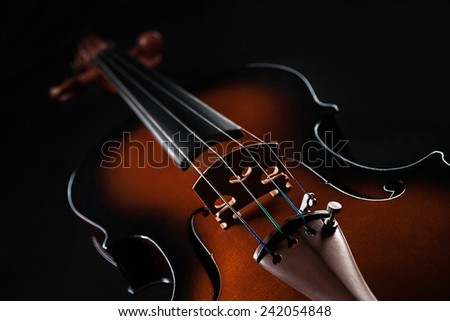 Beautiful red violin located on a black background - stock photo