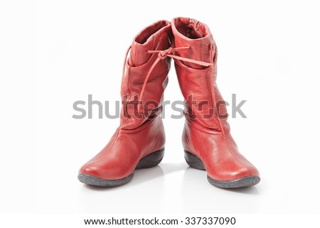 beautiful, red women's boots on a white background - stock photo