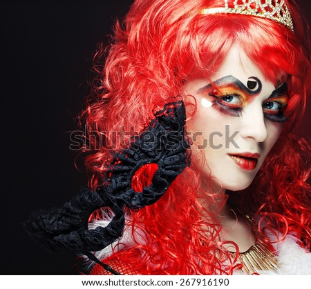 Beautiful redhair woman with mask. Carnaval visage. - stock photo
