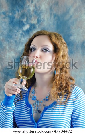 Beautiful redhaired woman drinking a cup of tea - stock photo