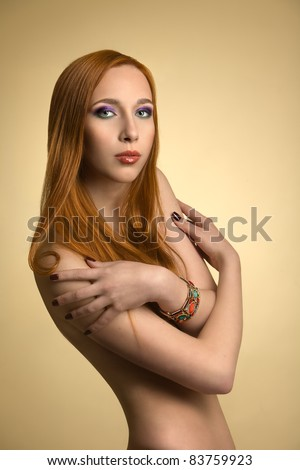 Beautiful redhead girl in studio - stock photo