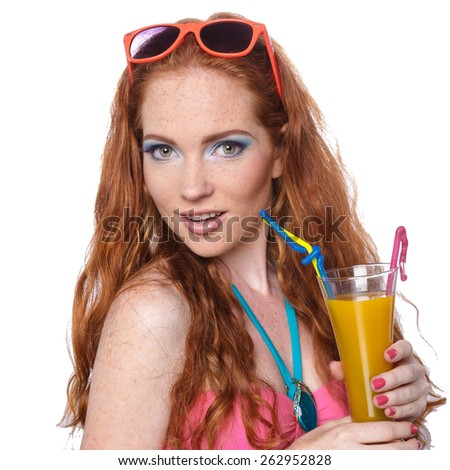 beautiful redhead girl in sunglasses with fresh orange juice