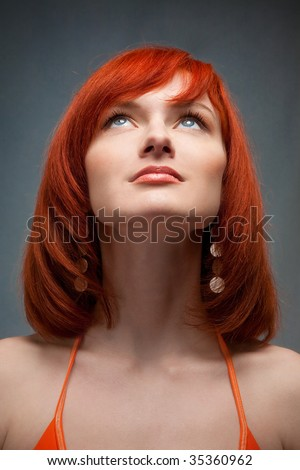 beautiful redhead girl looking up - stock photo