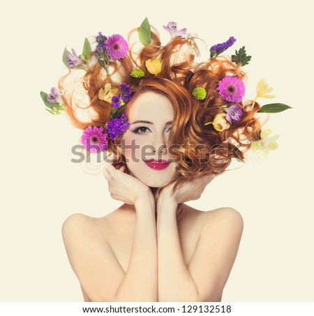 Beautiful redhead girl with flowers isolated. - stock photo