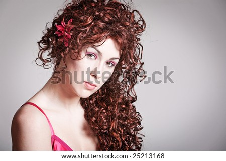 Beautiful redhead girl with long curly hair