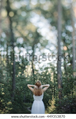 Beautiful redhead woman in the summer forest, Unusual selective focus