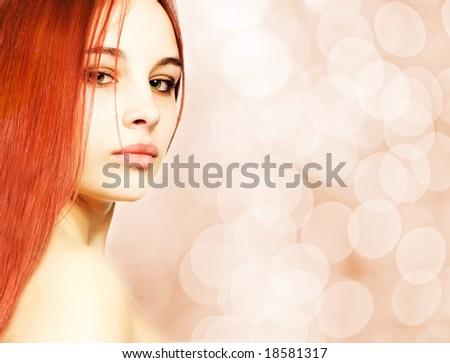 Beautiful redhead woman over abstract blurred background - stock photo