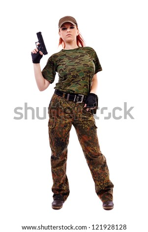 Beautiful redhead young woman with gun and military outfit, isolated on white background - stock photo