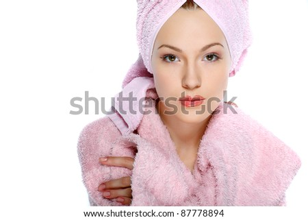 Beautiful redheaded girl in pink clothes isolated on a white background cosmetology, SPA