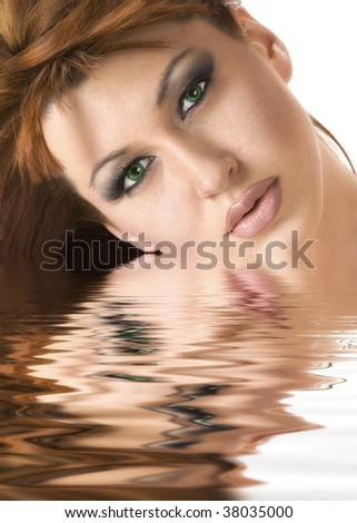 Beautiful redheaded woman reflected in water effect