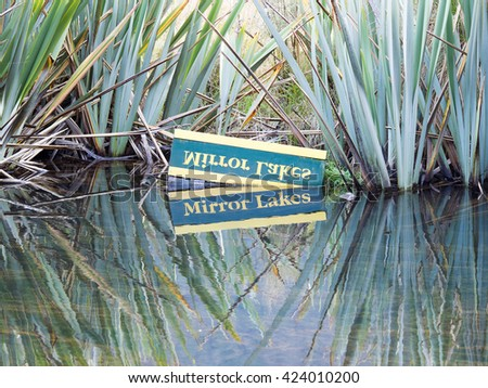 Beautiful reflect of Mirror Lake is a place to stop by on the Milford Road, New Zealand - stock photo