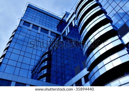 beautiful reflection in glass wall of modern skyscrapers - stock photo