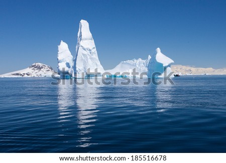 Beautiful reflection of Iceberg, Antarctica  - stock photo
