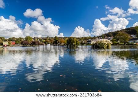 Beautiful reflections at Helston Boating Lake Cornwall England UK Europe - stock photo