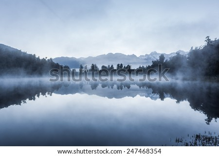 Beautiful reflections of Southern Alps at Lake Matheson on early morning, South Island, New Zealand - stock photo