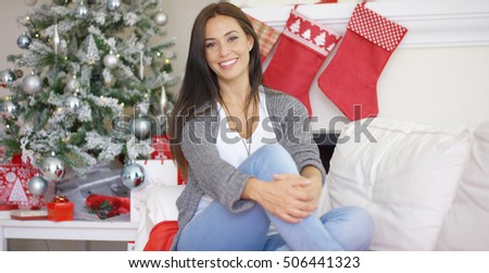 Beautiful relaxed woman celebrating Christmas