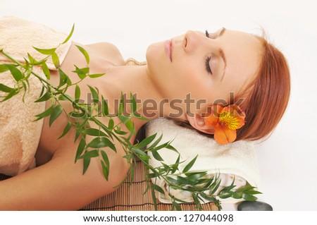 Beautiful relaxing woman in a Spa - stock photo