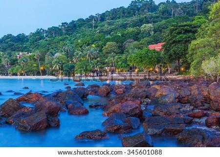 Beautiful resort on sea beach at sunset - stock photo