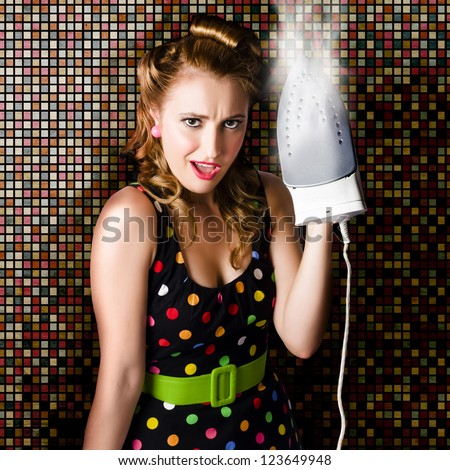 Beautiful Retro Housewife With Hot Style And Surprised Expression Steam Ironing Vintage Fashion Clothing - stock photo