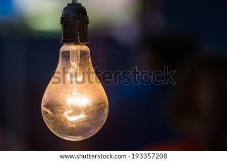 Beautiful retro luxury interior bulb lighting lamp decor glowing in dark. - stock photo