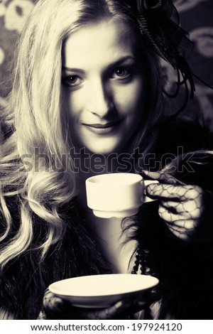 beautiful retro woman drinking coffee - stock photo
