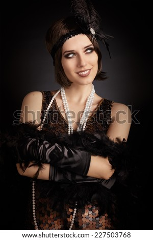 Beautiful retro woman from the roaring 20s ready to party - Vintage style image of a flapper girl  - stock photo
