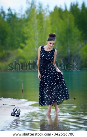 beautiful retro woman in vintage clothes at the lake - stock photo
