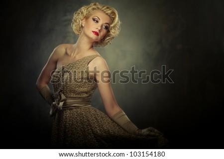 Beautiful retro woman on grey background - stock photo