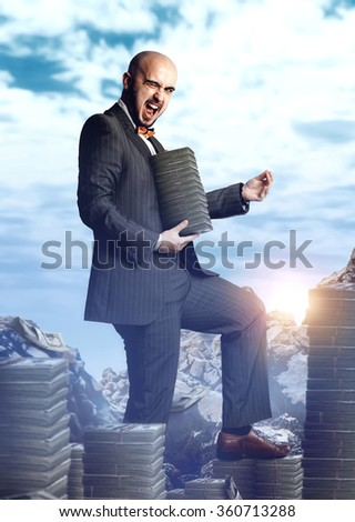 beautiful rich man in an expensive suit with a bunch of money around and in the hands. Business concept - stock photo