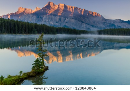 Beautiful ridged mountain as the sun rises - stock photo