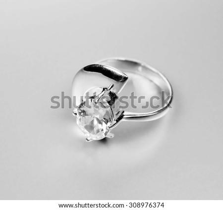 Beautiful ring isolated on grey background - stock photo