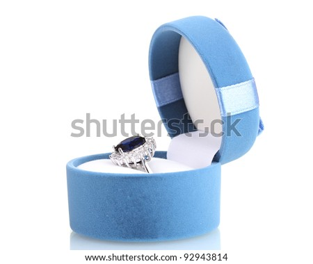 beautiful ring with blue gem in bag isolated on white - stock photo