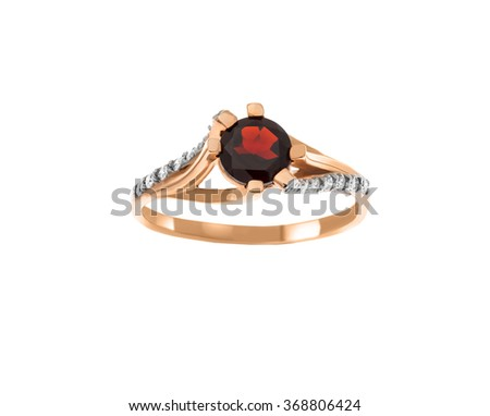 Beautiful ring with garnet and diamonds isolated on white... - stock photo