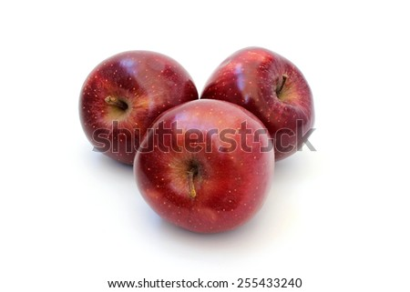 Beautiful ripe red apples lie on a white background - stock photo