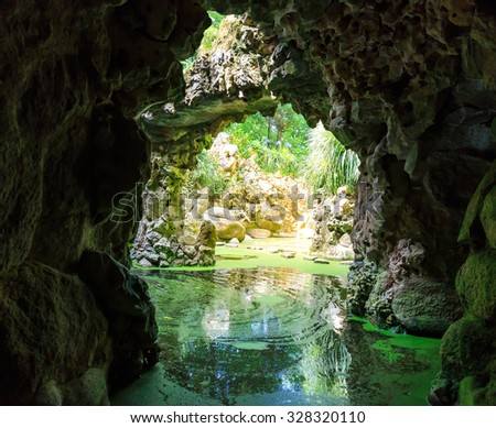 Beautiful river in caves in the forest - stock photo