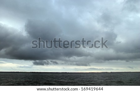 Beautiful river landscape in cloudy weather in summer