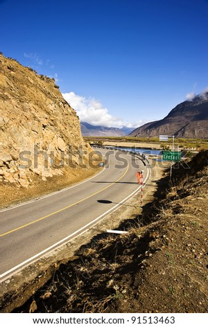 beautiful road in Tibet with blue sky and white cloud