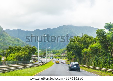 Beautiful road that goes through the jungle into the mighty mountains. - stock photo